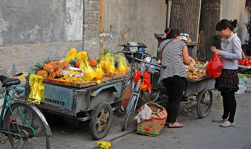 A vendor sells produce from tricycles. Photo by Tim Quijano.
