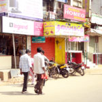 Men walk down the street in India