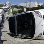 Smart car tipped in San Francisco, California. Photo by Jeff Chiu.