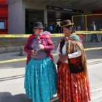 """Doñas Adelaida (left) and Estela ended their first trip on the teleférico at Taypi Uta (central station in the local Aymara language). Estela found the trip """"very beautiful."""" Adelaida added, """"and very fast! On normal transit, it would have taken us an hour or an hour and a half!"""" Photo by Gwen Kash."""