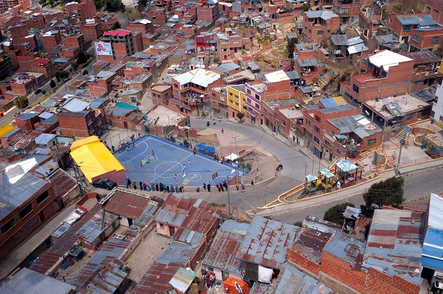 Residents of one of the neighborhoods perched on the steep mountainside at the edge of La Paz attend a nearby soccer match. Photo by Gwen Kash.