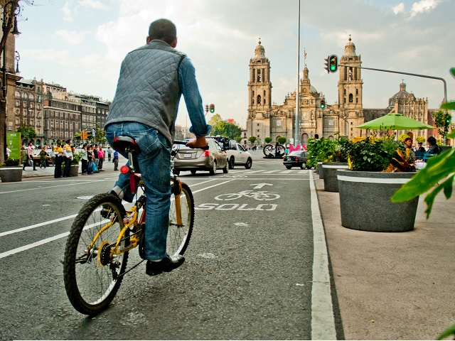 Biking down the street in Mexico City